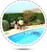 Property Management - Pool Cleaning Services, man cleaning an emptied swimming pool